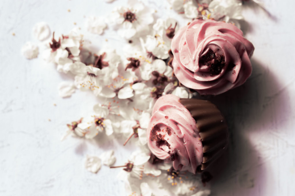 cupcakes on a bed of white cherryflowers, boho-style